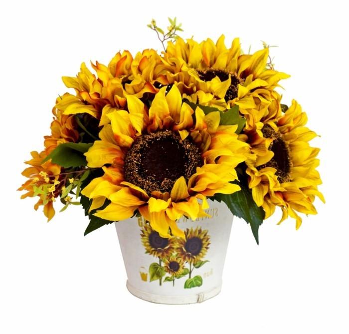 Künstliche-Sonnenblumen-und-Bild-auf-der-Vase