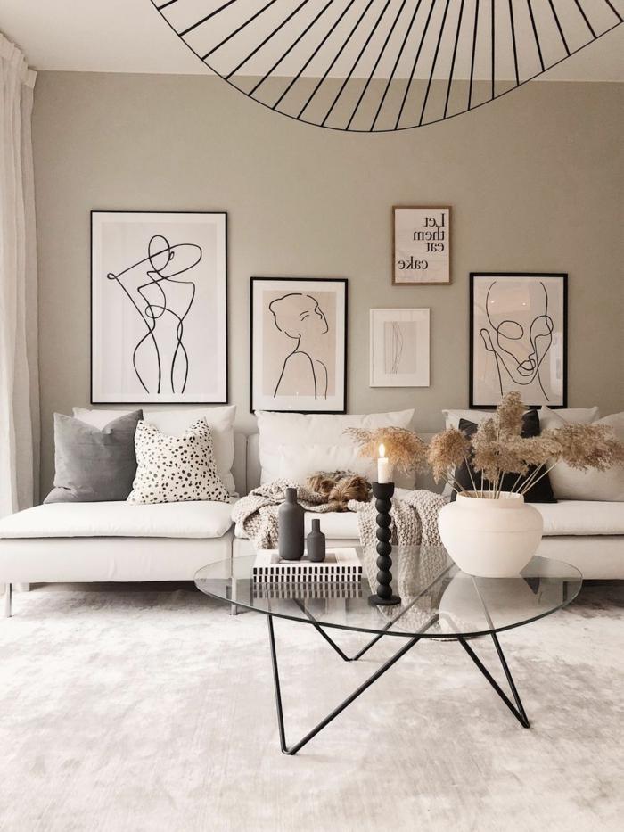 minimalistischer Einrichtungsstil, Pastellfarben, Streichzeichnungen, Wohnzimmer einrichten Beispiele, Glastisch