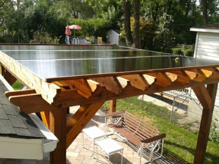 Freistehende-Terrassenüberdachun-aus-holz-und-glas