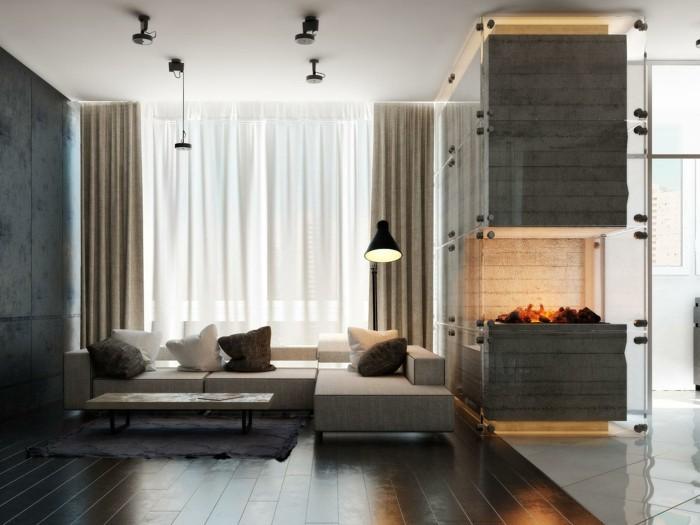 wunderschones-modell-glaskamin-in-luxuriosem-wohnzimmer