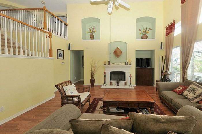 1wanddekowohnzimmer-zweistockige-wohnung-holzakzente-blaue-nischen