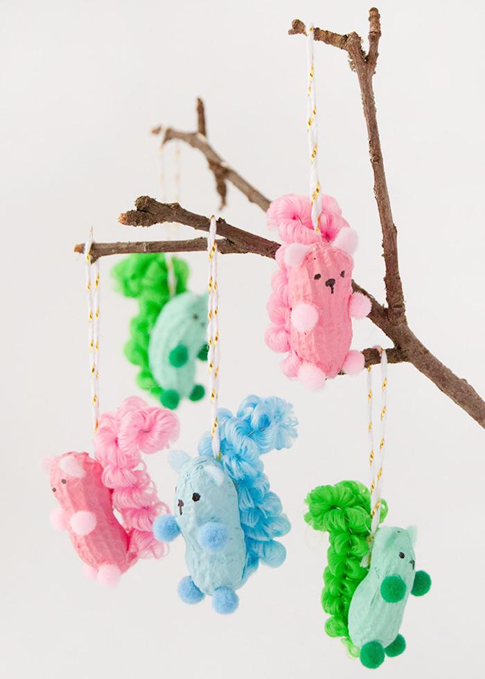 kreative bastelideen für kinder basteln mit erdnüssen Eichhörnchen basteln bunte ornamente originelle deko ideen inspiration