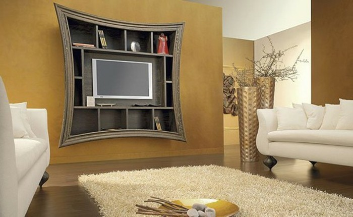 wanddekowohnzimmer-feuerstelle-pluschteppich-vasen-fernseher