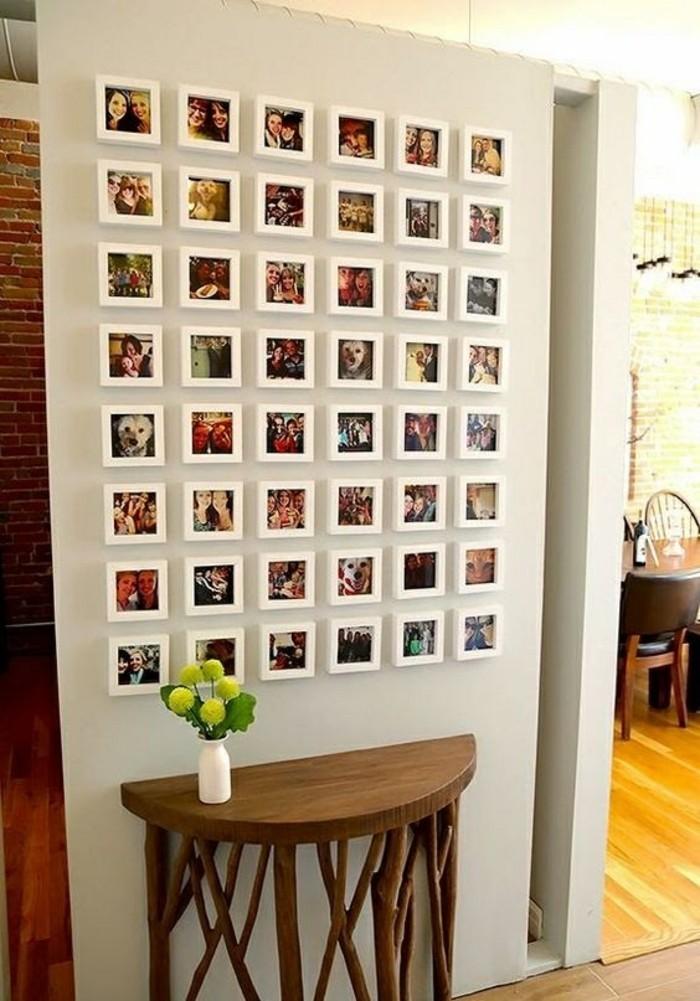 11-bilderrahmen-wand-mit-fotos-blumen-tisch-aus-holz-weise-vase