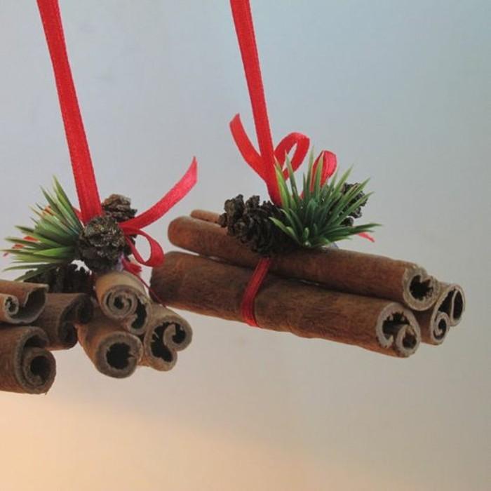 111-weihnachtsdeko-selber-machen-zimt-rote-schleife-grune-zweigen-zapfen