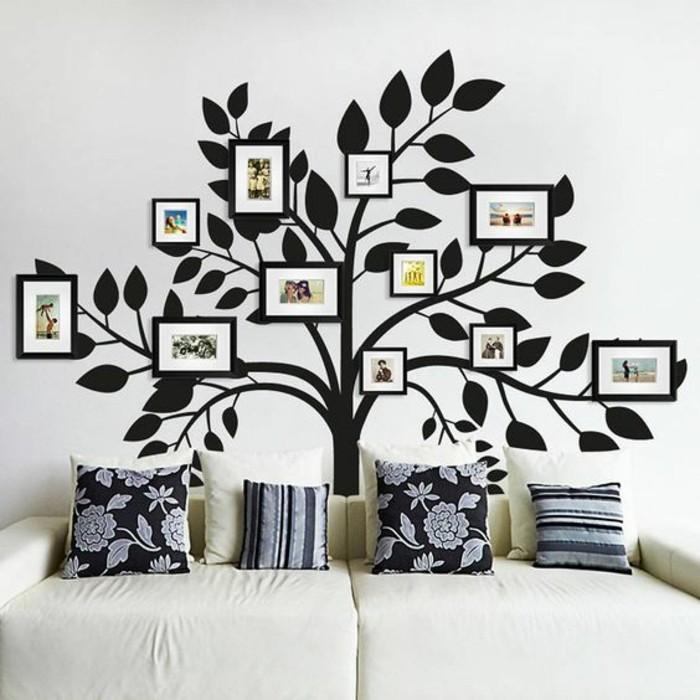 16-fotocollage-selber-machen-schwarzer-baum-mit-familienfotos-weiser-sofa-dekokissen