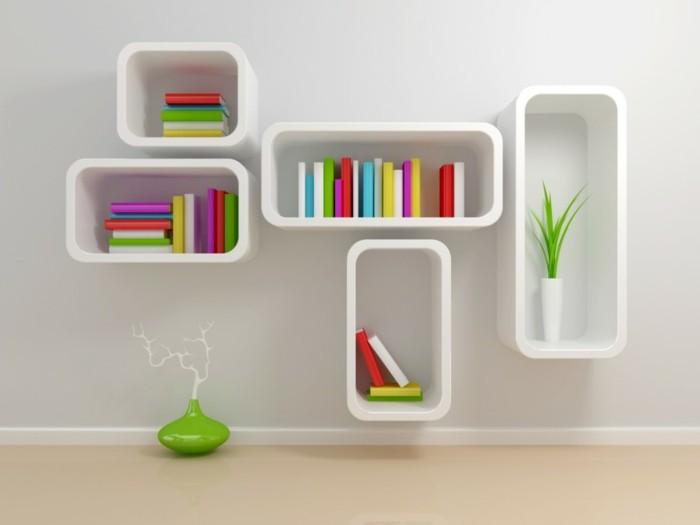 buecherregal-ideen-minimalistischen-stil-in-weisser-farbe-bunte-buecher-trockene-pflanze