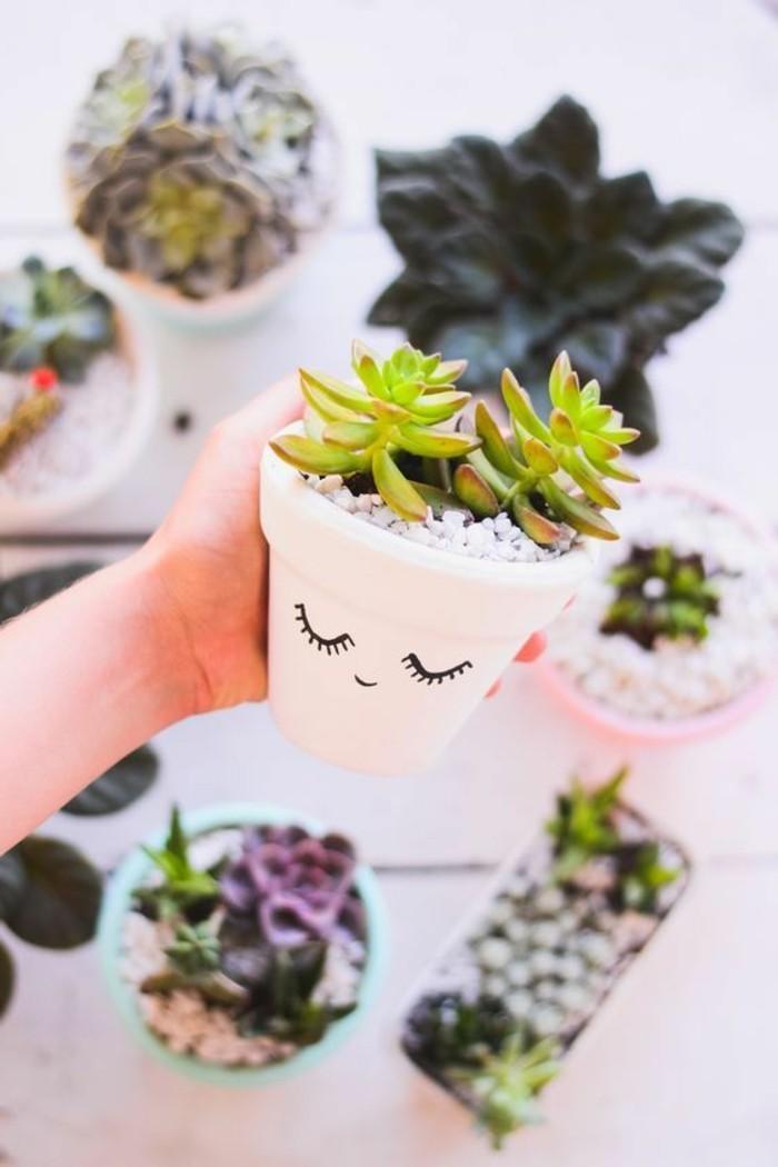 basteln-fuer-erwachsene-weisser-blumentopf-mit-augen-pflanzen