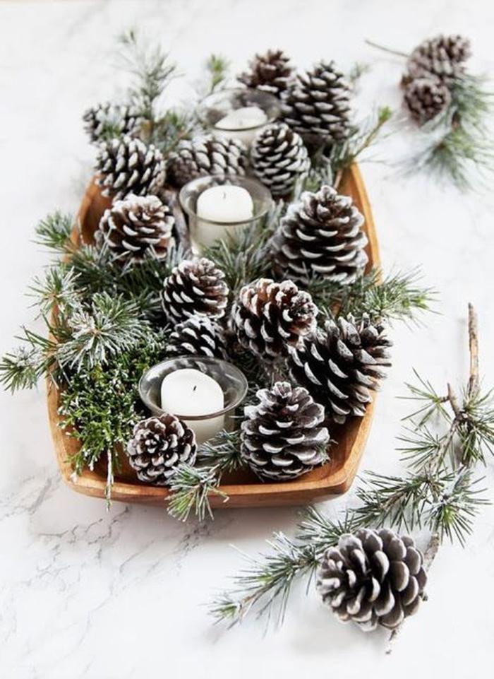bemalte zapfen tannenzweige kreative winterdeko basteln weihnachtsschmuck tannenbaum diy ideen und inspiration