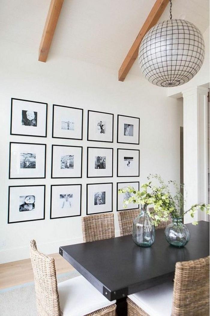 bilderrahmen-wand-lampenschirm-schwarzer-tisch-stuhle-vasen