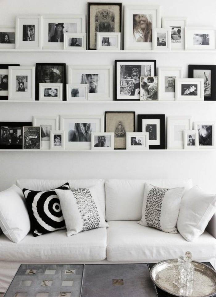 bilderrahmen-wand-weiser-sofa-dekokissen-tisch-fotos-wanddeko