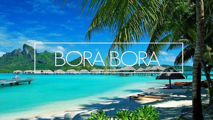 blaues meer blauer himmer bild von bora bora insel palmen sand strand gebirge häuser im wasser