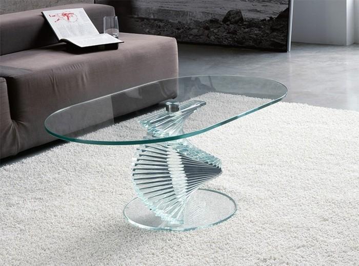 designer-couchtisch-glas-ovale-form-elegant-weisser-plueschteppich-marmorboden-braune-couch