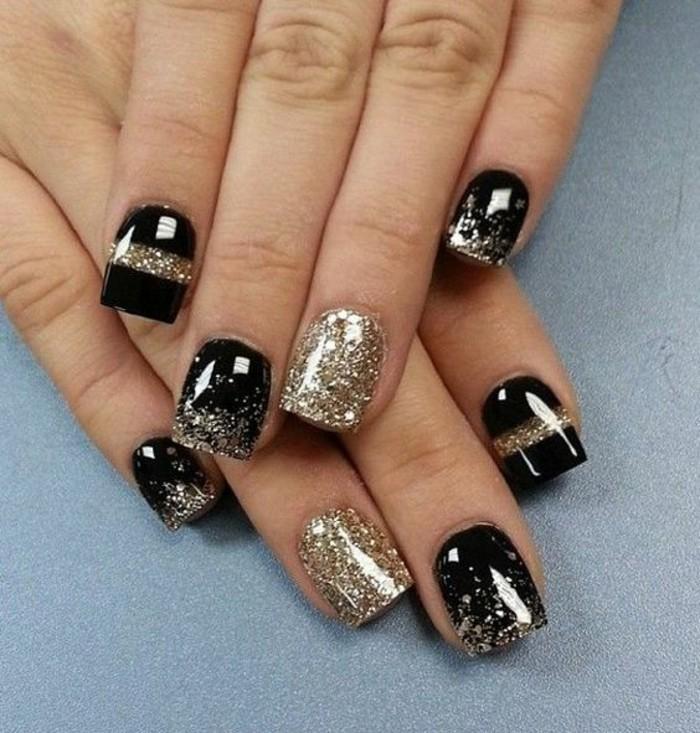 fingernageldesign-schwarz-und-gold-glitzer-silvester-winter-nagel