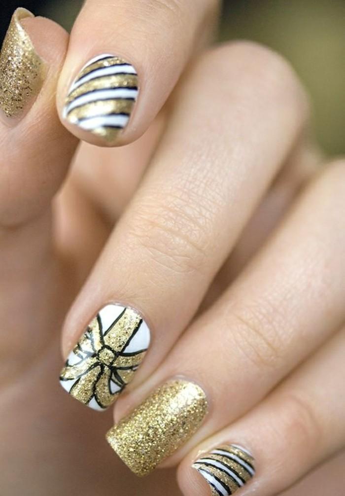fingernageldesign-weihnacten-gold-und-weis-schleifen-glitzer-finger-arm