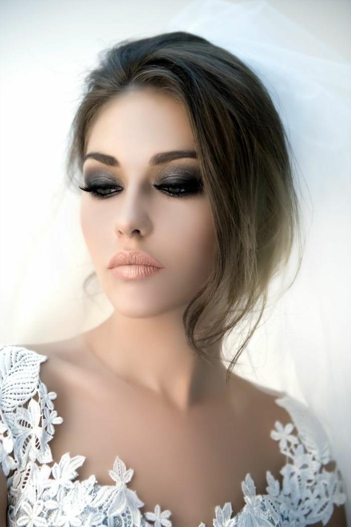 hochzeits-make-up-akzent-augen-braut-mit-grossen-augen-und-volle-lippen-orangen-lippenstift-schattierung-der-augen-smokey-lidschatten