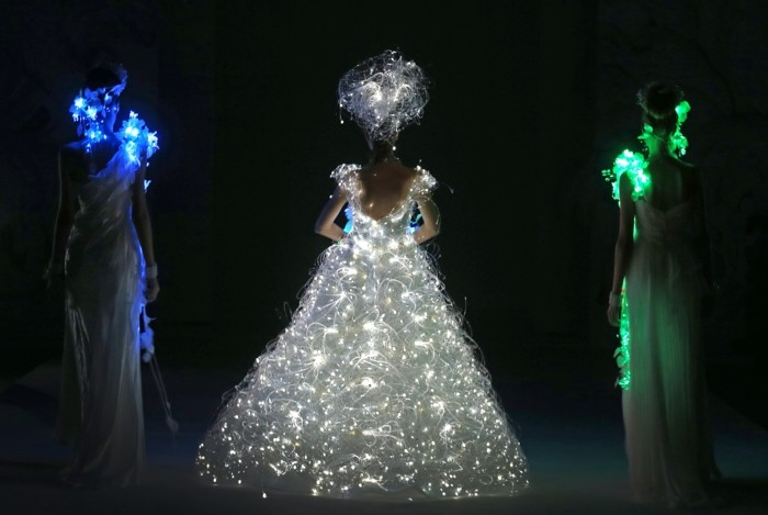 A model showcases a wedding dress that lights up by Japanese designer Yumi Katsura on Wednesday Nov. 28, 2012 in Singapore during the Japan Couture 2012 Singapore fashion show.(AP Photo/Wong Maye-E)