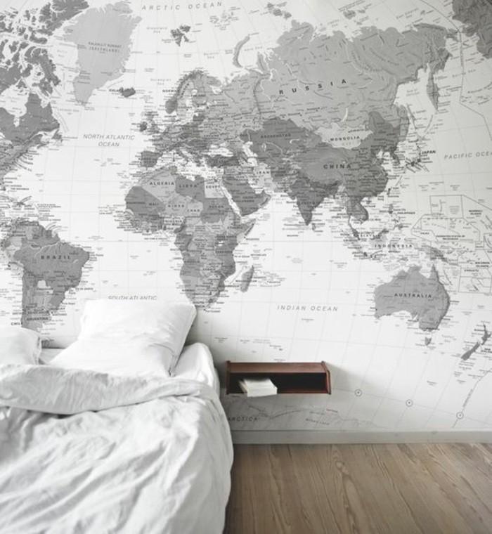 kreative-wandgestaltung-schlafzimmer-bett-kissen-erdteile-boden-aus-holz
