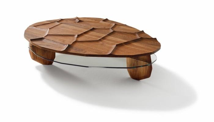 moderner-couchtisch-massivholz-und-glas-ovale-form-mit-relief-kurze-beine