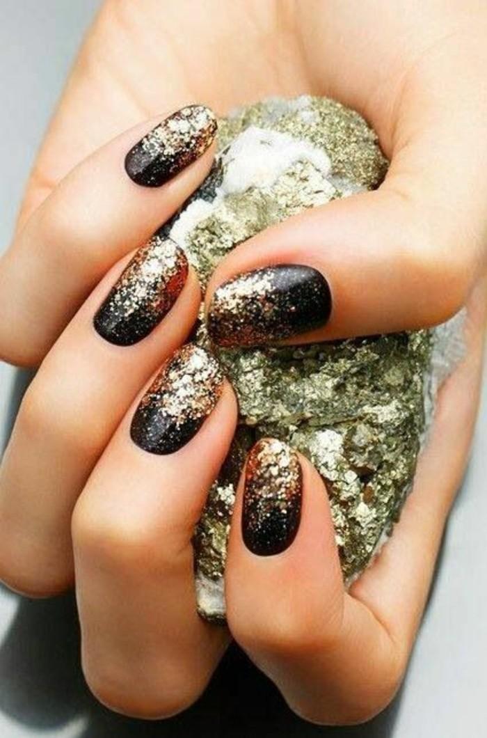 nageldesign-ideen-schwarz-und-gold-glitzer-nagellack-nagel-arm