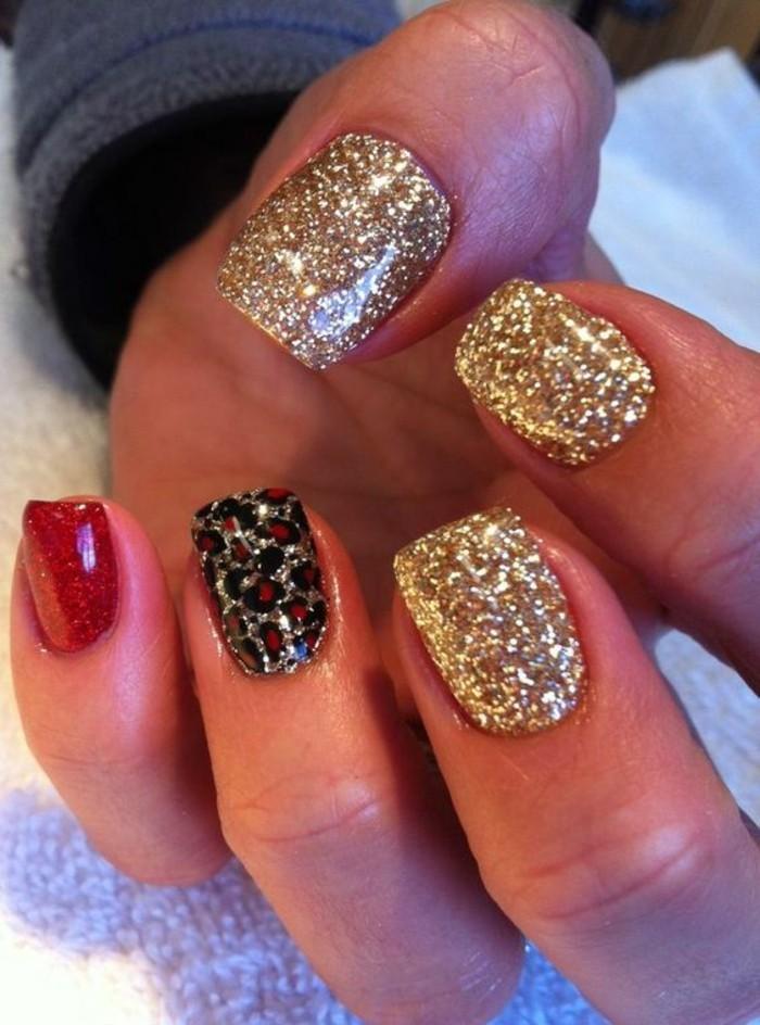 nageldesign-winter-rot-und-gold-nagelmuster-silvester-arm