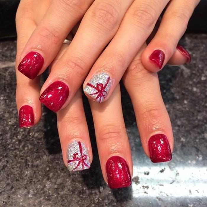 nageldesign-winter-rot-und-silber-schleife-finger-arm