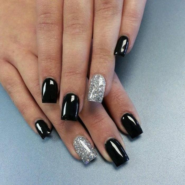 nageldesigns-schwarz-und-silber-glitzer-silvester-manikure-nagel