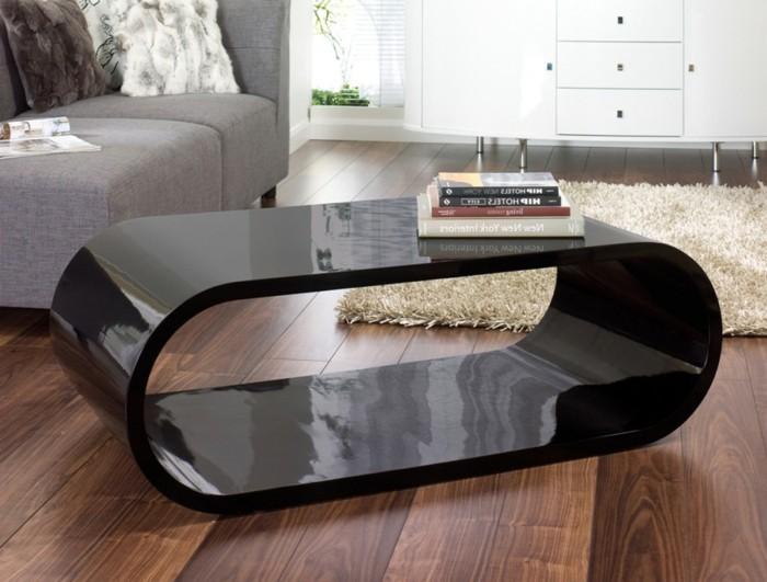 ovale-form-designer-couchtische-schwarz-holzboden-plueschteppich-beige-graue-couch