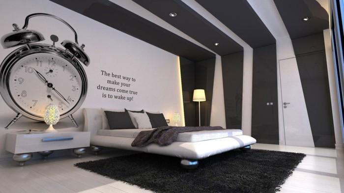 wanduhren-modern-wecker-wandspruch-lederbett-indirektes-licht-led-licht-schwarzer-teppich-weisser-boden