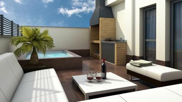 balkongestaltung-wein-gläser-sofa-hocker-schwimmbad-holz-palme