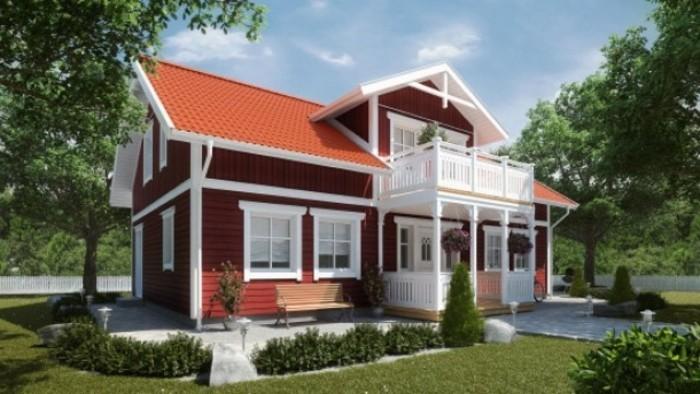 falunrote-fassade-weisse-holzhaus-mit-veranda-schöne-gartengestaltung