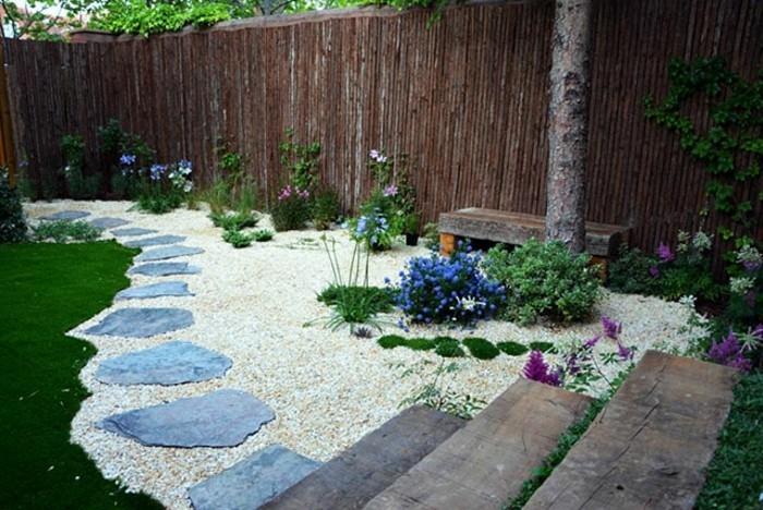 1001 ideen zum thema blumenbeet mit steinen dekorieren - Holzzaun garten ...