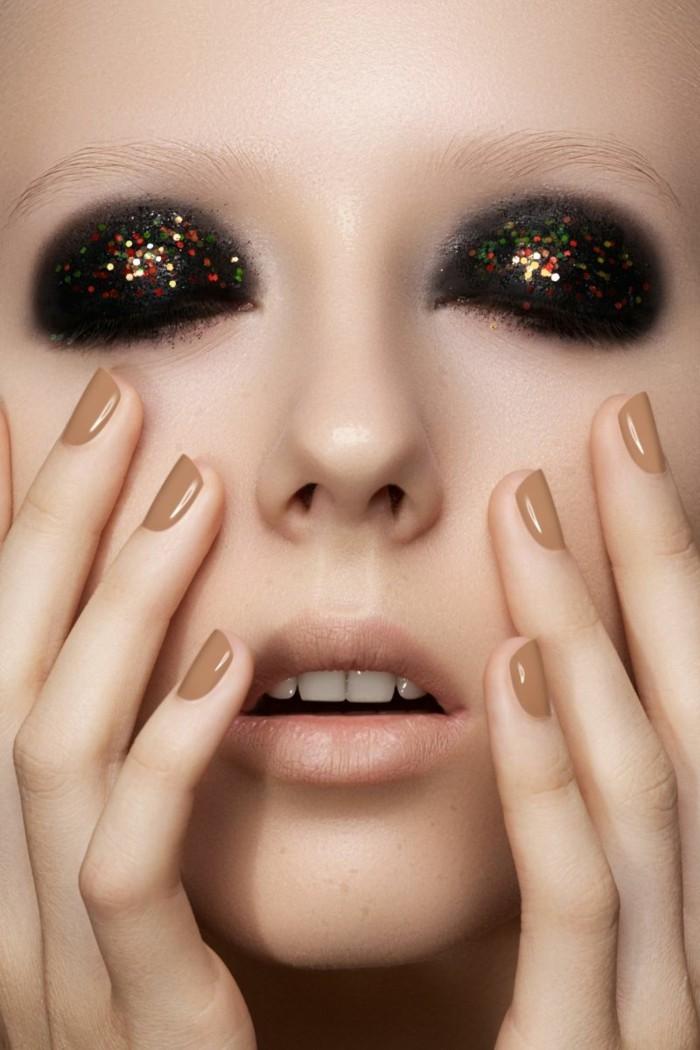geschminkte-augen-akzent-auf-augen-dunkle-lidschatten-mit-glanz-natuerliche-toene-naegel-lippen