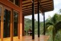 Das amerikanische Holzhaus mit Veranda