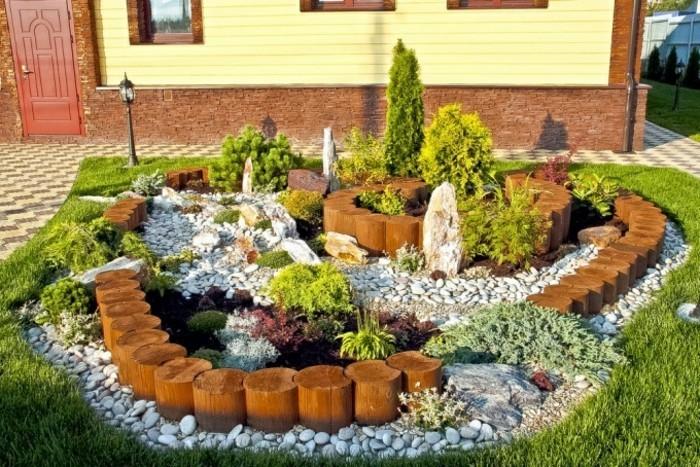 schöne-gärten-vorgarten-gestalten-holzdeko-garten-stendeko-außenbeleuchtung