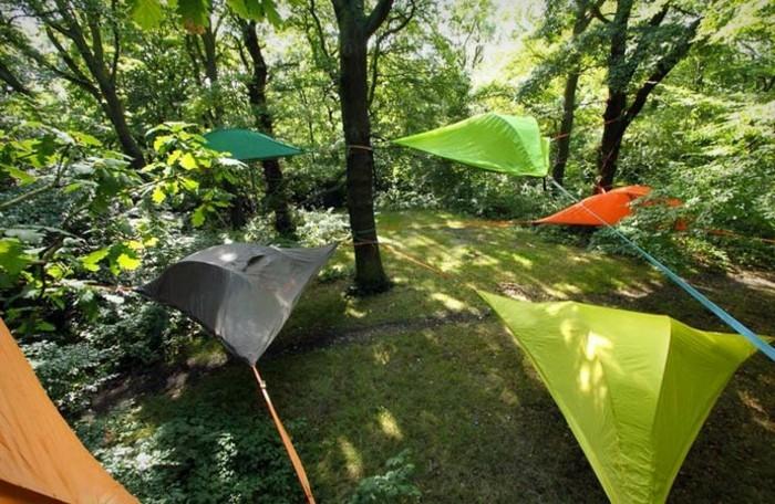 verschiedene-campingzelte-gelbes-oranges, grünes-baumzelt