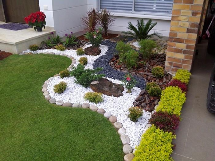 vorgarten-gestalten-deko-mit-weißen-und-schwarzen-steinen-garten-haus-mit-steinwand