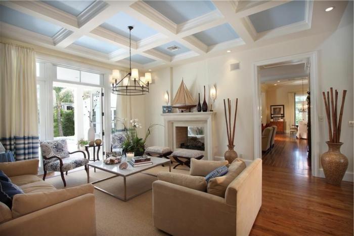 1offener-kamin-wohnzimmer-esszimmer-dekorative-vasen-designer-couchtisch-beige-möbel-polsterstuhl