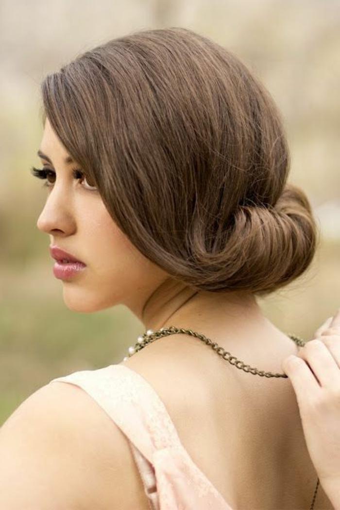 dame mit braunen haaren und fantastischer frisur