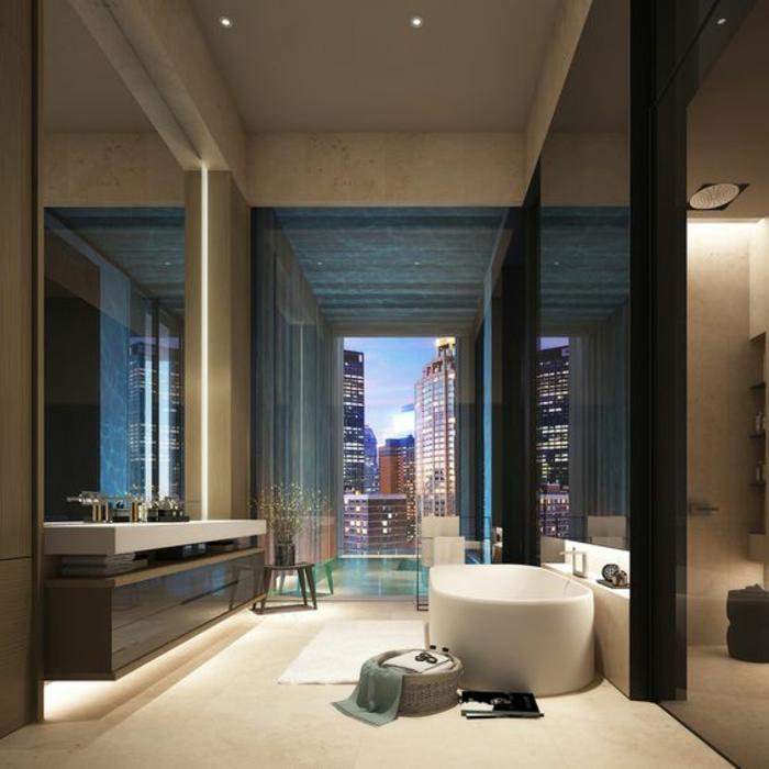 modernes badezimmer mit ovaler badewanne und großem fenster