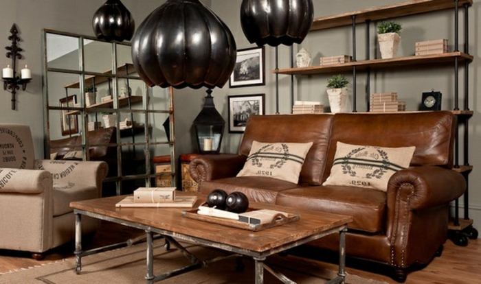 6industrial-möbel-wohnzimmer-ledercouch-braun-tisch-massivholz-metallbeine-regal-holz-metall-rollen