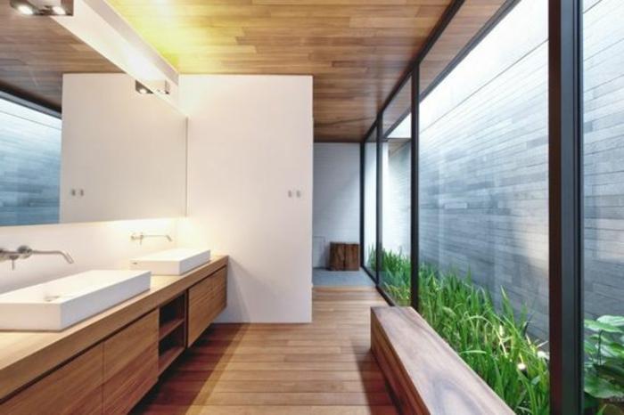 badezimmer gestalten mit waschbecken mit unterschrank und einem großen, eckigen spiegel