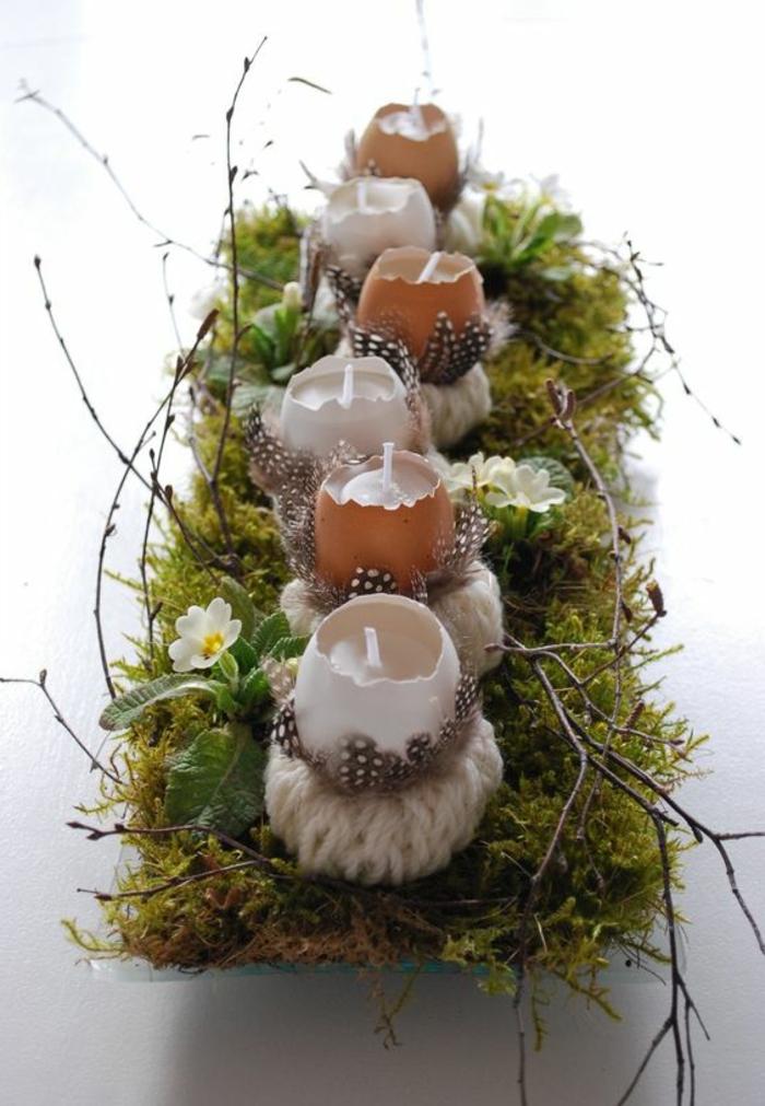 dekoideen-frühling-osterdeko-mit-moos-aus-gebrochene-eier-und-Kerzen