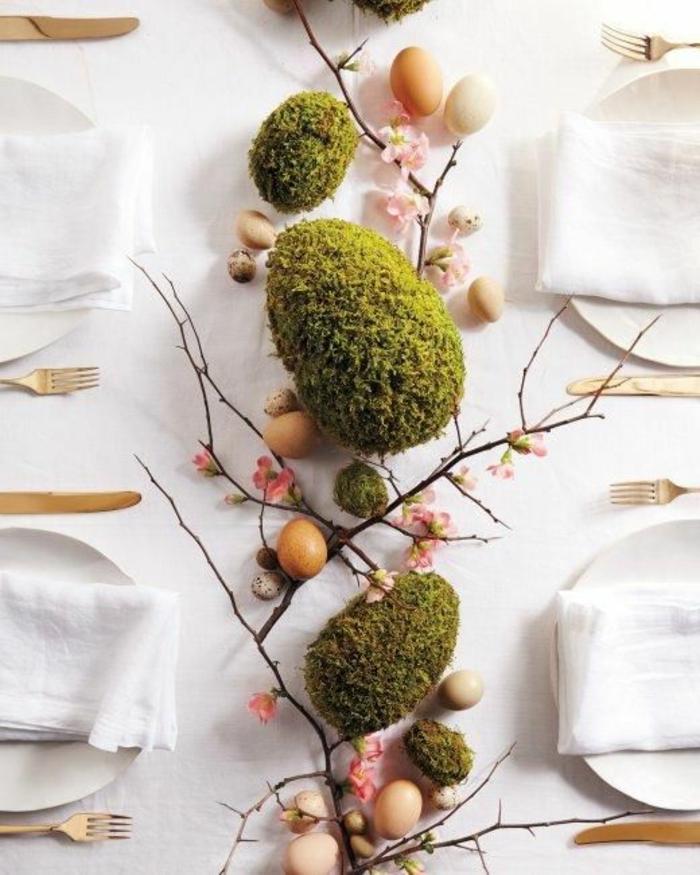 dekoideen-frühling-osterdeko-mit-moos-ostereier-und-zweige
