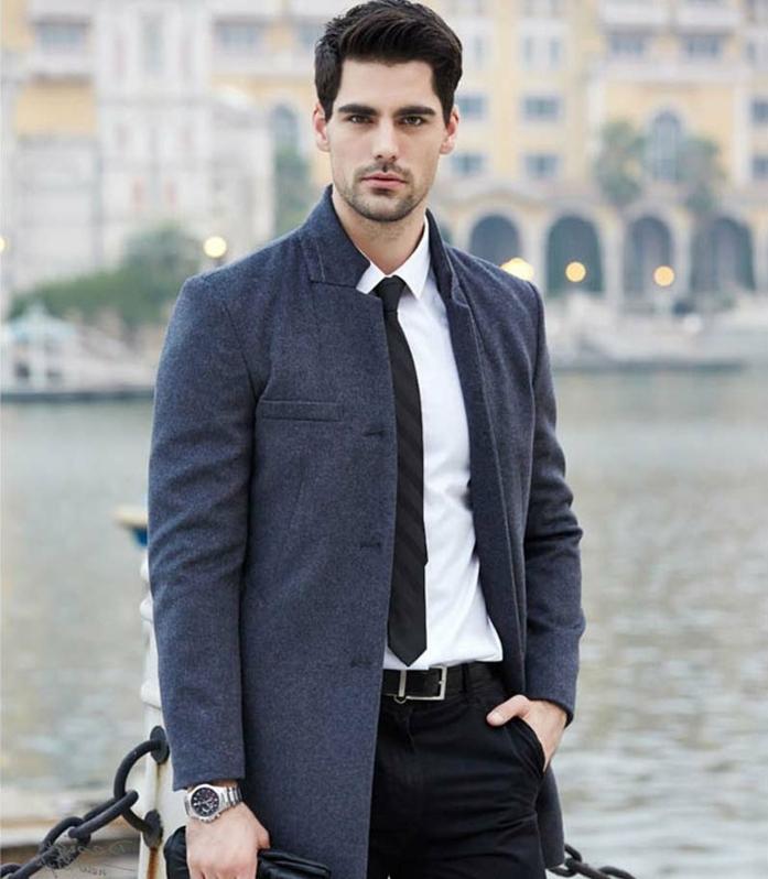 elegant dezenter mann stil mit schwarzen hosen weißem hemd grauem blazer handschuhe armbanduhr