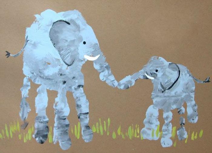 ein großer und ein kleiner elefant - bild mit handabdruck