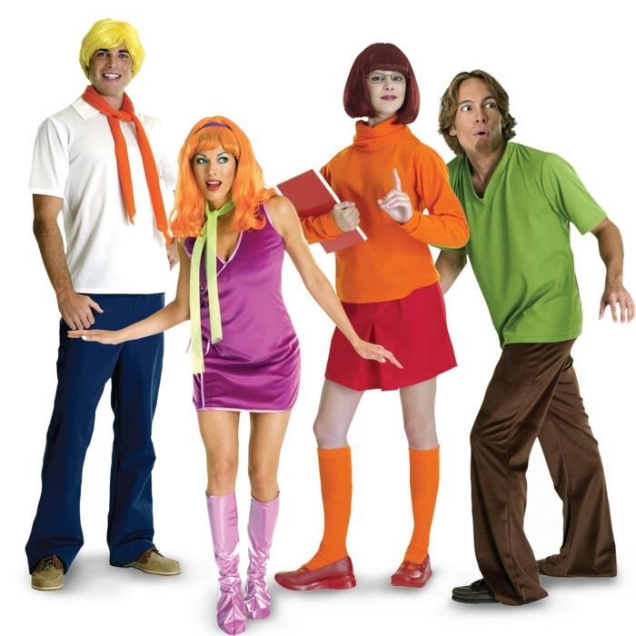 Kostüm Gruppe aus Scooby Doo ohne den Hund von zwei Jungen und zwei Mädchen