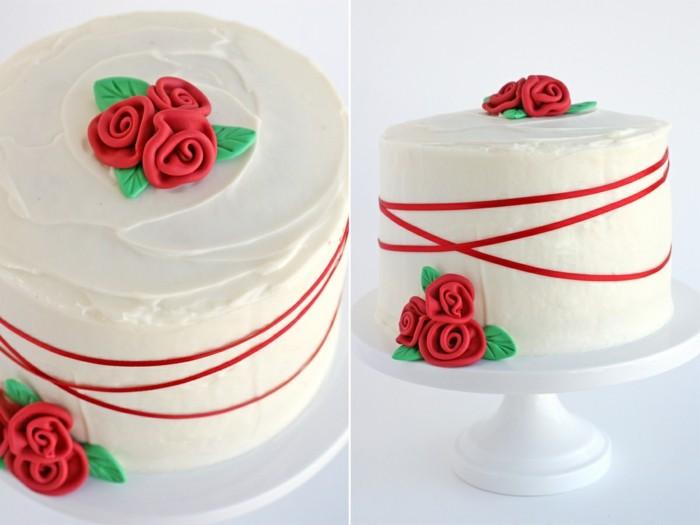 roter-samt-kuchen-mit-weisser-fondant-bedeckung-rote-farbe-fondant-figuren-rosen-torte-hochzeitstorte