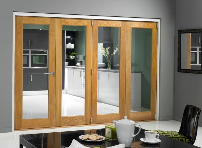 schiebetür-küche-glastür-harmonikatür-holz-glas-schwarzer-esstisch-lackiert-grüne-küchenwand-musterkisse