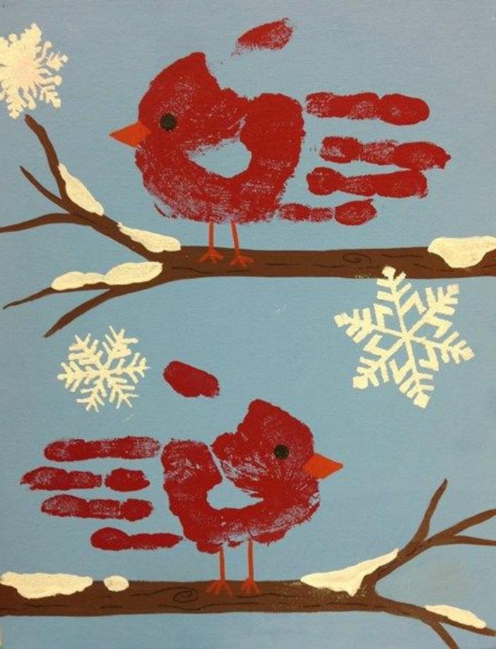 zwei rote vögel und scghneeflocken -handabdruck bilder